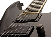 Black electro-guitar — Stock Photo