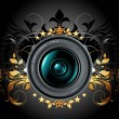 Camera photo lens with ornamental elements — Imagen vectorial