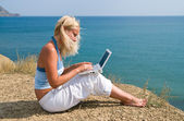Girl with netbook — Stock Photo