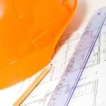 Orange helmet, pencil, ruler and blueprint — Stock Photo