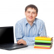 Young adullt man sitting with laptop — Stock Photo