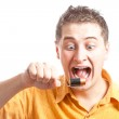 Mad man eating battery — Stock Photo #3348175