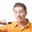 Man trying to eat battery — Stock Photo #3348179