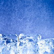 Fresh blue ice cubes background — Stock Photo