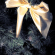 Yellow ribbon on fur tree - Stock Photo
