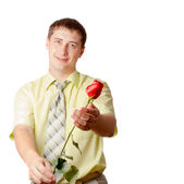 Young adult man with red rose — Stock Photo