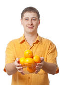 Man with orange fruits in hands — Stock Photo