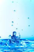 Salpicaduras de agua congelada azul — Foto de Stock