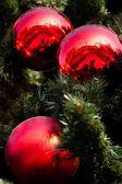 Three big red christmas balls — Stock Photo