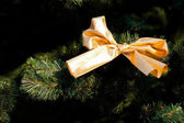 Gold christmas bow on fur-tree — Stock Photo