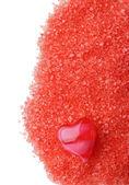 Oil red heart on salt — Stock Photo