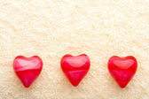 Three oil hearts on towel — Stock Photo