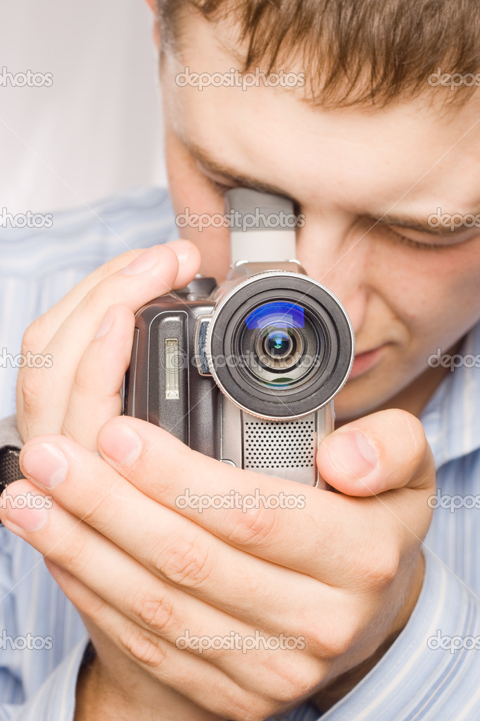 Closeup man portrait with videocamera — Stock Photo #3343893