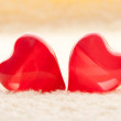 Macro two red hearts on towel — Stock Photo