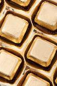 Closeup gold chocolate — Stock Photo