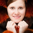 Woman portrait in fur hood — Stock Photo