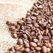 Coffee beans on hessian — Stock Photo