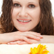 Closeup woman portrait laying on towel - Stock Photo