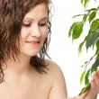 Woman touching green plant - Stockfoto