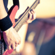 Red guitar playing — Stock Photo