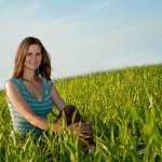 Woman sitting on grass — Stock Photo #3451420