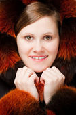 Woman portrait in fur hood — Stock Photo