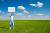 Woman with blank advert poster — Stock Photo
