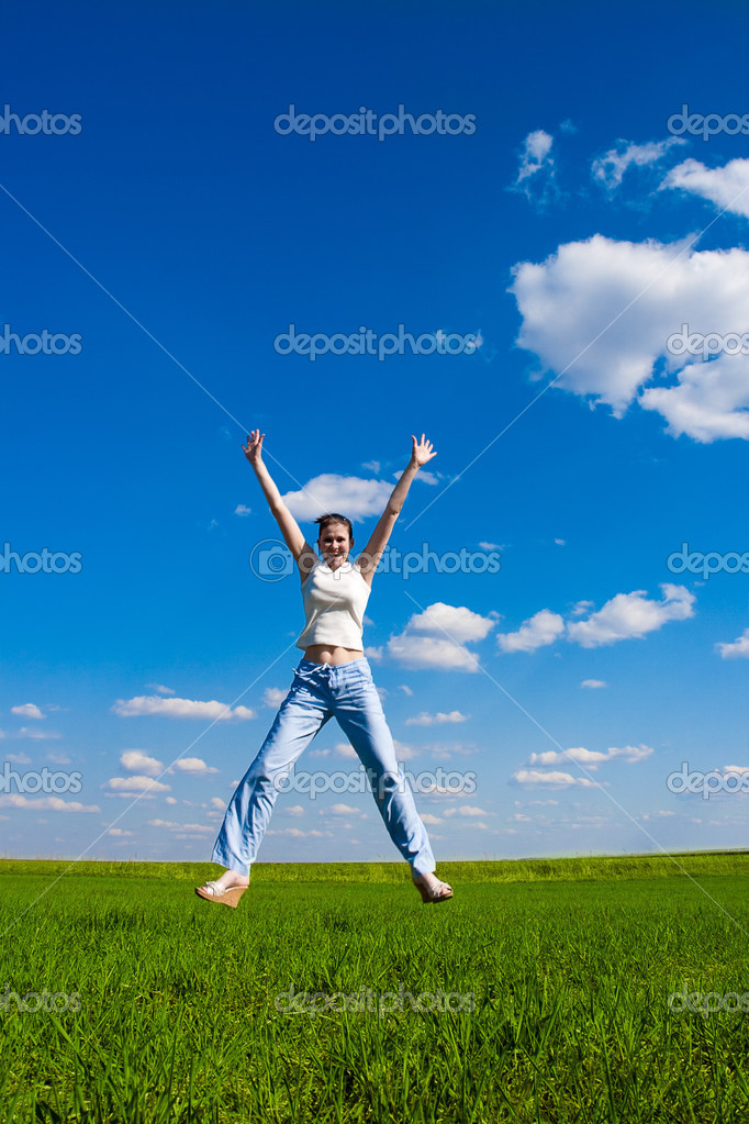 Young woman jumping over blue sky  Stock Photo #3450827