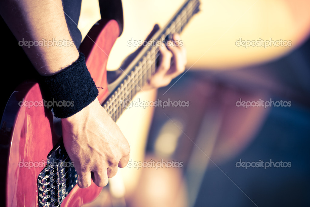 Man playing on red guitar — Foto de Stock   #3451090