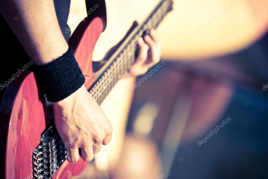 Man playing on red guitar — Stok fotoğraf #3451090