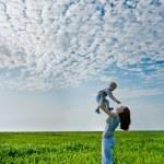 Woman holding boy — Stock Photo #3482419