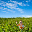 Boy on green field — Stock Photo #3483308