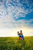 Couple in the field — Stock Photo