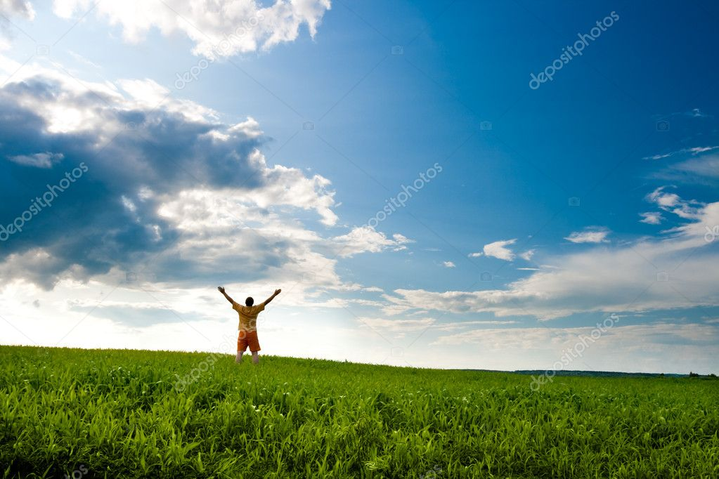 Man standing on field  Stock Photo #3482476