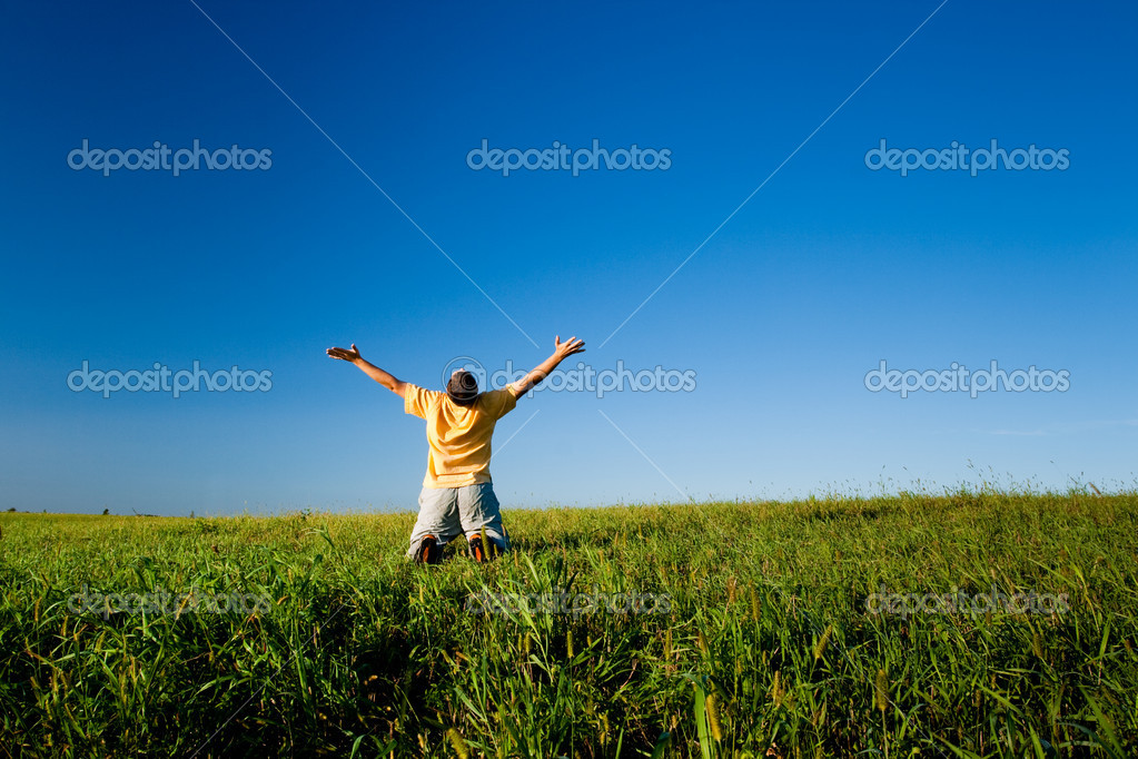 Man praying under clear blue skies — Stock Photo #3482662