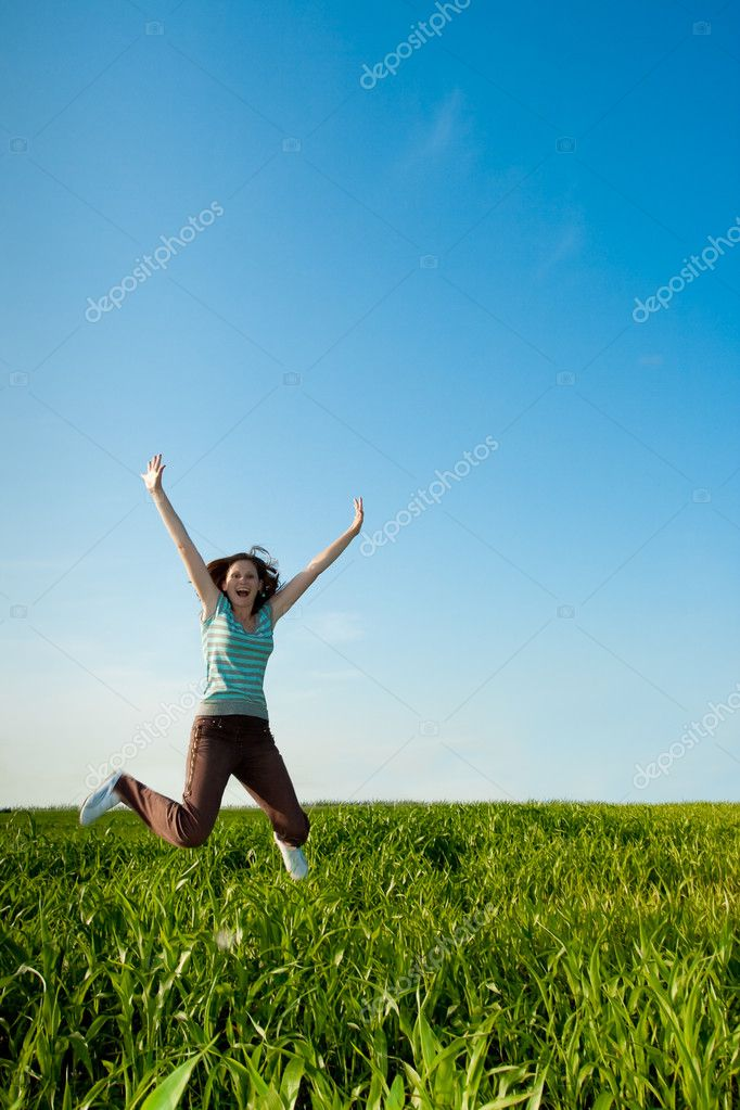 Young woman jumping on geen field — Stock Photo #3482779