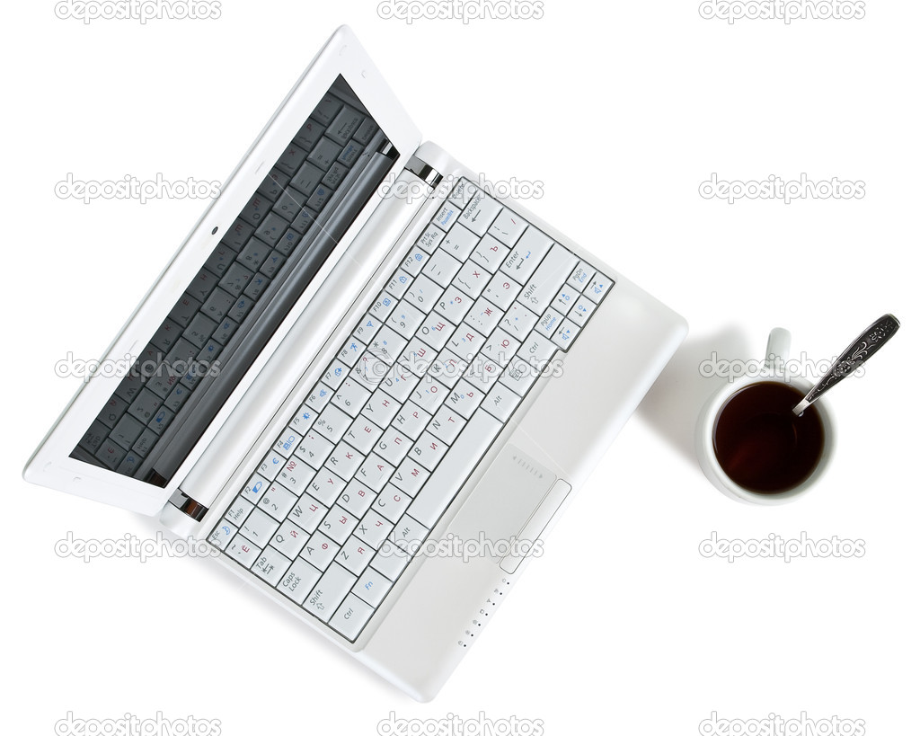 White netbook with black coffee top view — Stock Photo #3482957