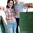 Stock Photo: Young adult couple shopping