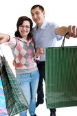 Young adult couple shopping — Stock Photo