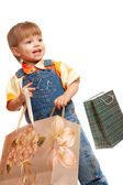 Little boy with bags — Stockfoto