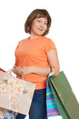Smiling woman with bags — Stock Photo