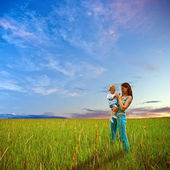 Mother and son on the filed — Stock Photo