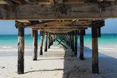 Wooden pier on the beach — Stock Photo