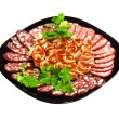 Cutting Smoked Sausage Bacon And Parsley On Black Plate — Lizenzfreies Foto