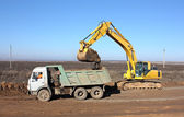 Dredge and dump-body truck — Stock Photo
