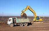 Dredge and dump-body truck — Stock Photo