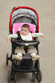 Cute baby in the stroller — Stock Photo