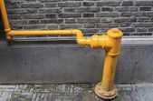 Pipe on the wall — Stock Photo