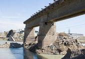 Ruined bridge through river — Stock Photo