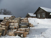 Snowy winter in the village. Wooden house. — Stock Photo